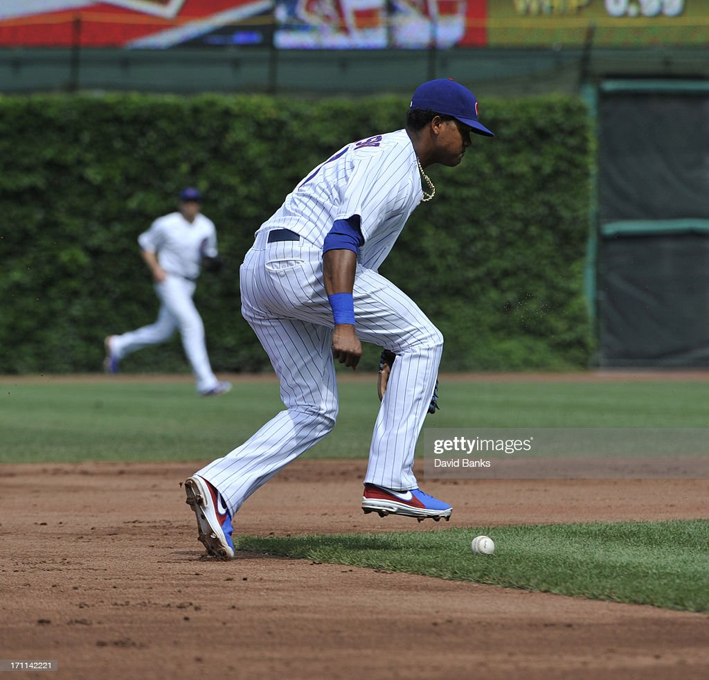 Starlin Castro #13 of the Chicago Cubs makes an error against the Houston Astros during the third inning on June 22, 2013 at Wrigley Field in Chicago, Illinois.