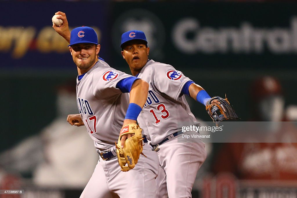 <a gi-track='captionPersonalityLinkClicked' href=/galleries/search?phrase=Starlin+Castro&family=editorial&specificpeople=5970945 ng-click='$event.stopPropagation()'>Starlin Castro</a> #13 of the Chicago Cubs mimics <a gi-track='captionPersonalityLinkClicked' href=/galleries/search?phrase=Kris+Bryant+-+Baseball+Player&family=editorial&specificpeople=14019446 ng-click='$event.stopPropagation()'>Kris Bryant</a> #17 of the Chicago Cubs as Bryant throws a runner out at first base against the St. Louis Cardinals in the sixth inning at Busch Stadium on May 6, 2015 in St. Louis, Missouri.