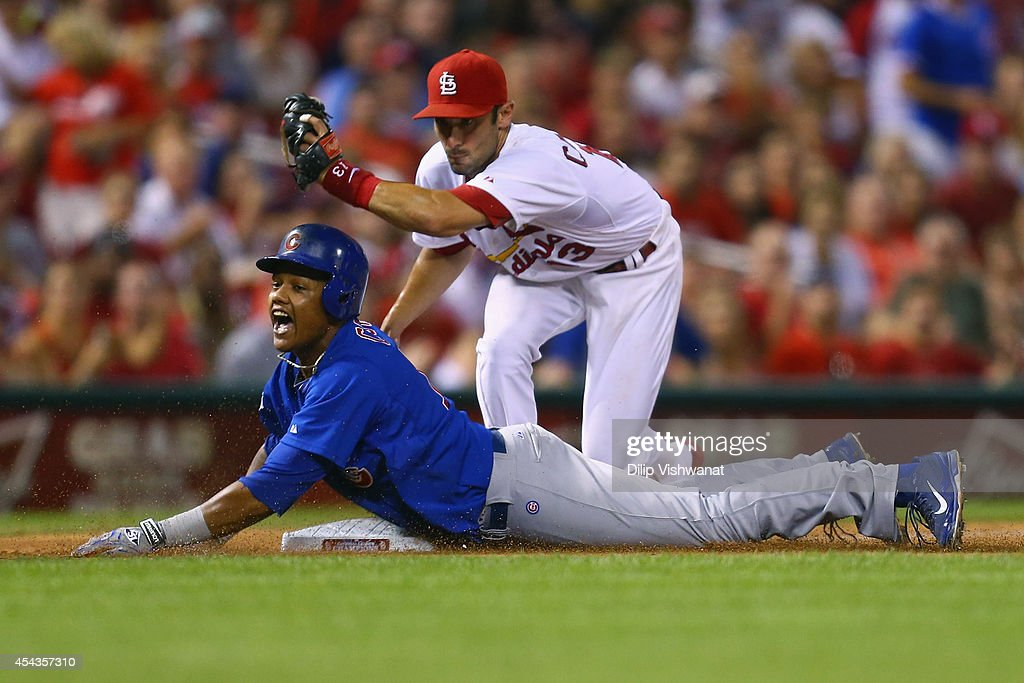 <a gi-track='captionPersonalityLinkClicked' href=/galleries/search?phrase=Starlin+Castro&family=editorial&specificpeople=5970945 ng-click='$event.stopPropagation()'>Starlin Castro</a> #13 of the Chicago Cubs reacts after being tagged out at third base by Matt Carpenter #13 of the St. Louis Cardinals while trying to run out a triple in the sixth inning at Busch Stadium on August 29, 2014 in St. Louis, Missouri. The Cubs beat the Cardinals 7-2.