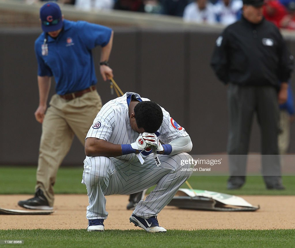 <a gi-track='captionPersonalityLinkClicked' href=/galleries/search?phrase=Starlin+Castro&family=editorial&specificpeople=5970945 ng-click='$event.stopPropagation()'>Starlin Castro</a> #13 of the Chicago Cubs reacts after grounding out with the bases loaded to end the 6th inning against the Cincinnati Reds as members of the grounds crew drag in the infield dirt at Wrigley Field on May 6, 2011 in Chicago, Illinois. The Reds defeated the Cubs 5-4.