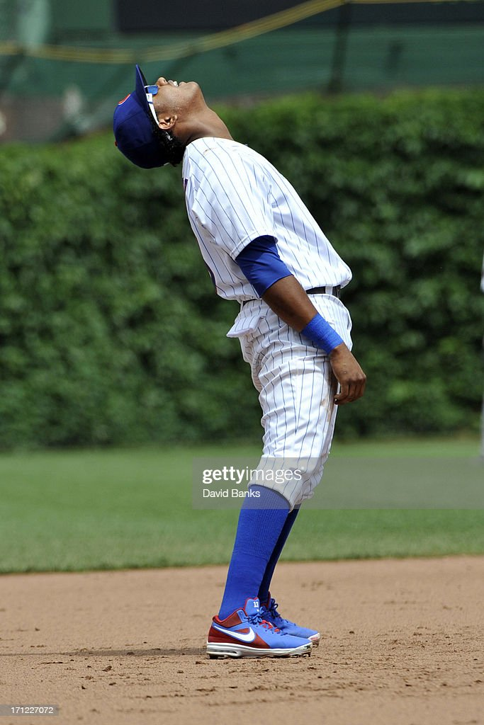 <a gi-track='captionPersonalityLinkClicked' href=/galleries/search?phrase=Starlin+Castro&family=editorial&specificpeople=5970945 ng-click='$event.stopPropagation()'>Starlin Castro</a> #13 of the Chicago Cubs reacts after making an error against the Houston Astros during the fifth inning on June 23, 2013 at Wrigley Field in Chicago, Illinois.