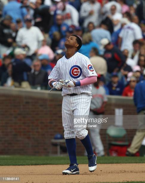 Starlin Castro of the Chicago Cubs reacts after making the third out in the 7th inning with the bases loaded against the Cincinnati Reds at Wrigley...