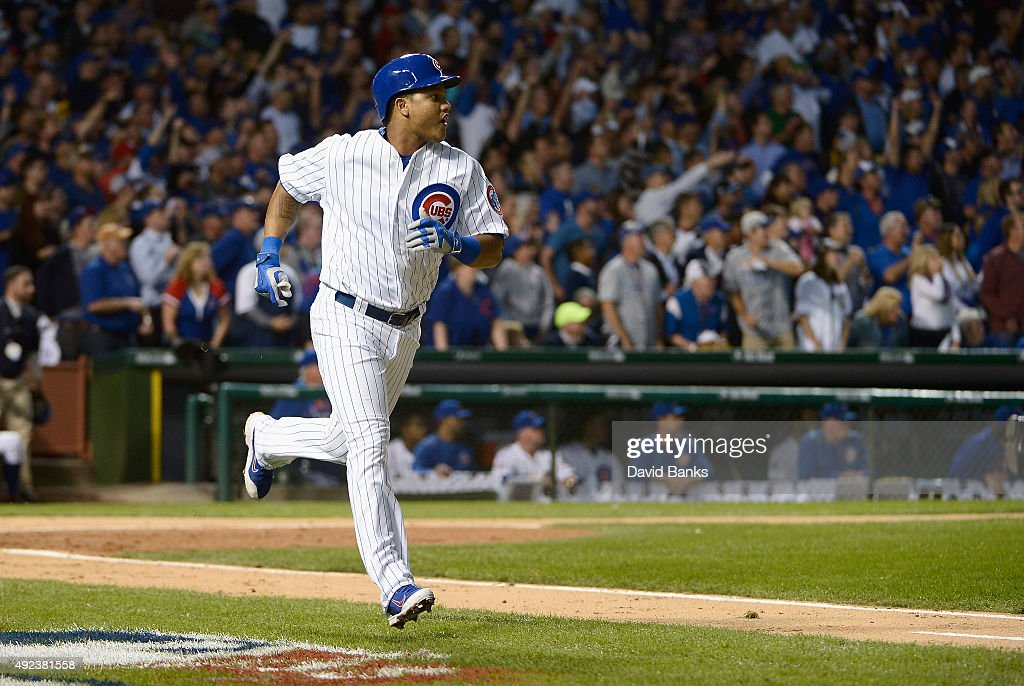 <a gi-track='captionPersonalityLinkClicked' href=/galleries/search?phrase=Starlin+Castro&family=editorial&specificpeople=5970945 ng-click='$event.stopPropagation()'>Starlin Castro</a> #13 of the Chicago Cubs runs the bases after hitting a solo home run in the fourth inning against the St. Louis Cardinals during game three of the National League Division Series at Wrigley Field on October 12, 2015 in Chicago, Illinois.