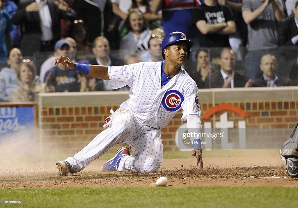 Starlin Castro #13 of the Chicago Cubs scores against the San Diego Padres in the seventh inning on May 1, 2013 at Wrigley Field in Chicago, Illinois.