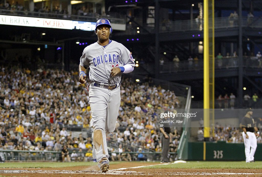 <a gi-track='captionPersonalityLinkClicked' href=/galleries/search?phrase=Starlin+Castro&family=editorial&specificpeople=5970945 ng-click='$event.stopPropagation()'>Starlin Castro</a> #13 of the Chicago Cubs scores on an RBI single in the third inning against the Pittsburgh Pirates during the game on September 7, 2012 at PNC Park in Pittsburgh, Pennsylvania.