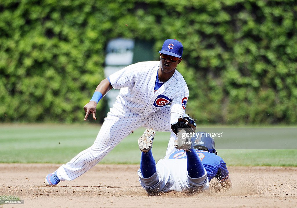 <a gi-track='captionPersonalityLinkClicked' href=/galleries/search?phrase=Starlin+Castro&family=editorial&specificpeople=5970945 ng-click='$event.stopPropagation()'>Starlin Castro</a> #13 of the Chicago Cubs tags out Daniel Murphy #28 of the New York Mets on a steal attempt during the third inning on May 18, 2013 at Wrigley Field in Chicago, Illinois.