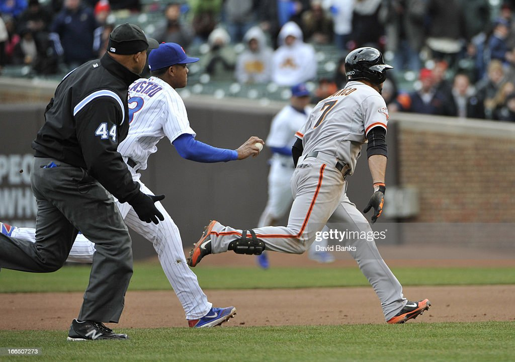 <a gi-track='captionPersonalityLinkClicked' href=/galleries/search?phrase=Starlin+Castro&family=editorial&specificpeople=5970945 ng-click='$event.stopPropagation()'>Starlin Castro</a> #13 of the Chicago Cubs tags out <a gi-track='captionPersonalityLinkClicked' href=/galleries/search?phrase=Gregor+Blanco&family=editorial&specificpeople=4137600 ng-click='$event.stopPropagation()'>Gregor Blanco</a> #7 of the San Francisco Giants during the fifth inning on April 13, 2013 at Wrigley Field in Chicago, Illinois.