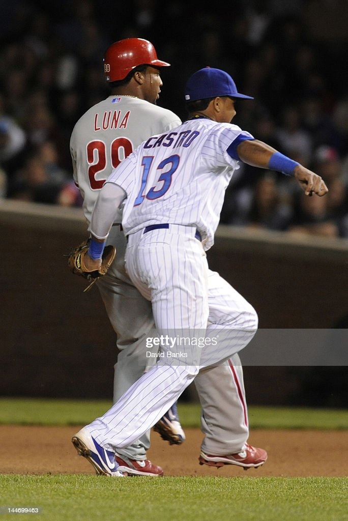<a gi-track='captionPersonalityLinkClicked' href=/galleries/search?phrase=Starlin+Castro&family=editorial&specificpeople=5970945 ng-click='$event.stopPropagation()'>Starlin Castro</a> #13 of the Chicago Cubs tags out <a gi-track='captionPersonalityLinkClicked' href=/galleries/search?phrase=Hector+Luna&family=editorial&specificpeople=216471 ng-click='$event.stopPropagation()'>Hector Luna</a> #29 of the Philadelphia Phillies in the seventh inning on May 17, 2012 at Wrigley Field in Chicago, Illinois.