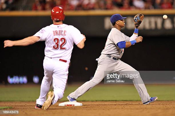 Starlin Castro of the Chicago Cubs takes the throw for the force out of Jay Bruce of the Cincinnati Reds in the sixth inning at Great American Ball...