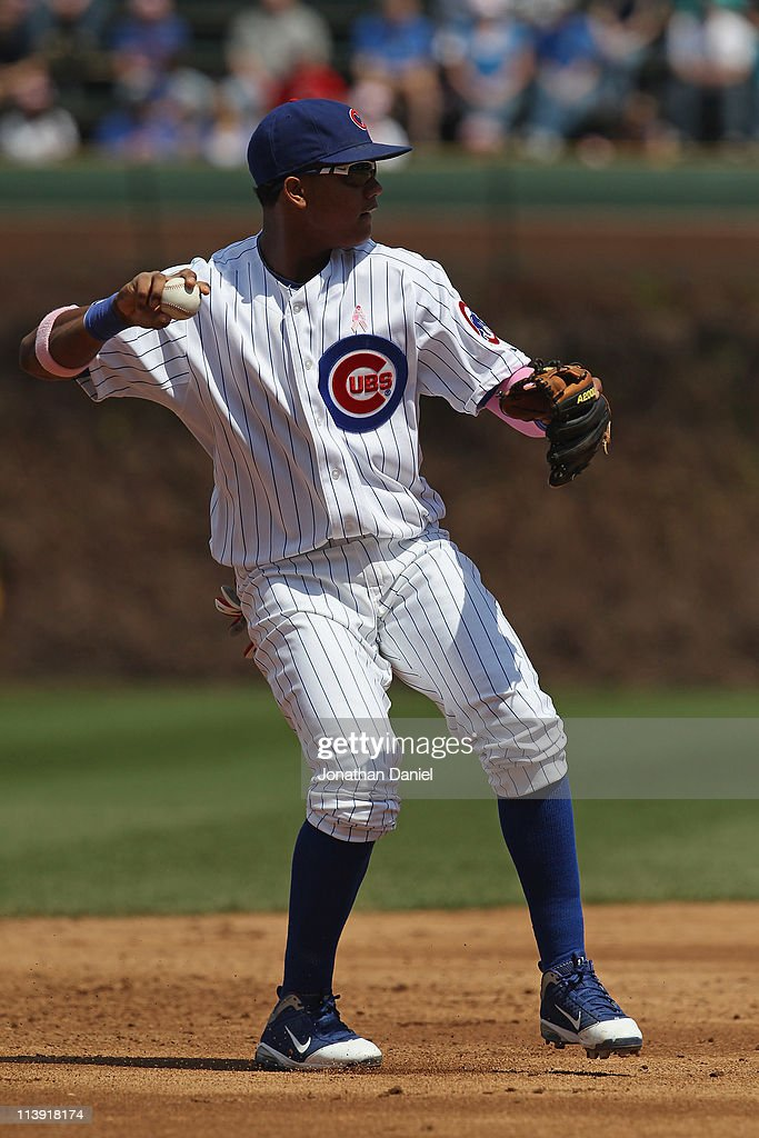 Starlin Castro #13 of the Chicago Cubs throws to 1st base against the Cincinnati Reds at Wrigley Field on May 8, 2011 in Chicago, Illinois. The Reds defeated the Cubs 2-0.