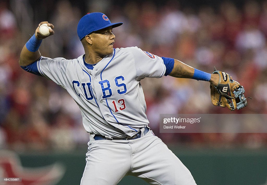 <a gi-track='captionPersonalityLinkClicked' href=/galleries/search?phrase=Starlin+Castro&family=editorial&specificpeople=5970945 ng-click='$event.stopPropagation()'>Starlin Castro</a> #13 of the Chicago Cubs throws to first for an out in the second inning during a game against the St. Louis Cardinals at Busch Stadium on April 11, 2014 in St. Louis, Missouri.
