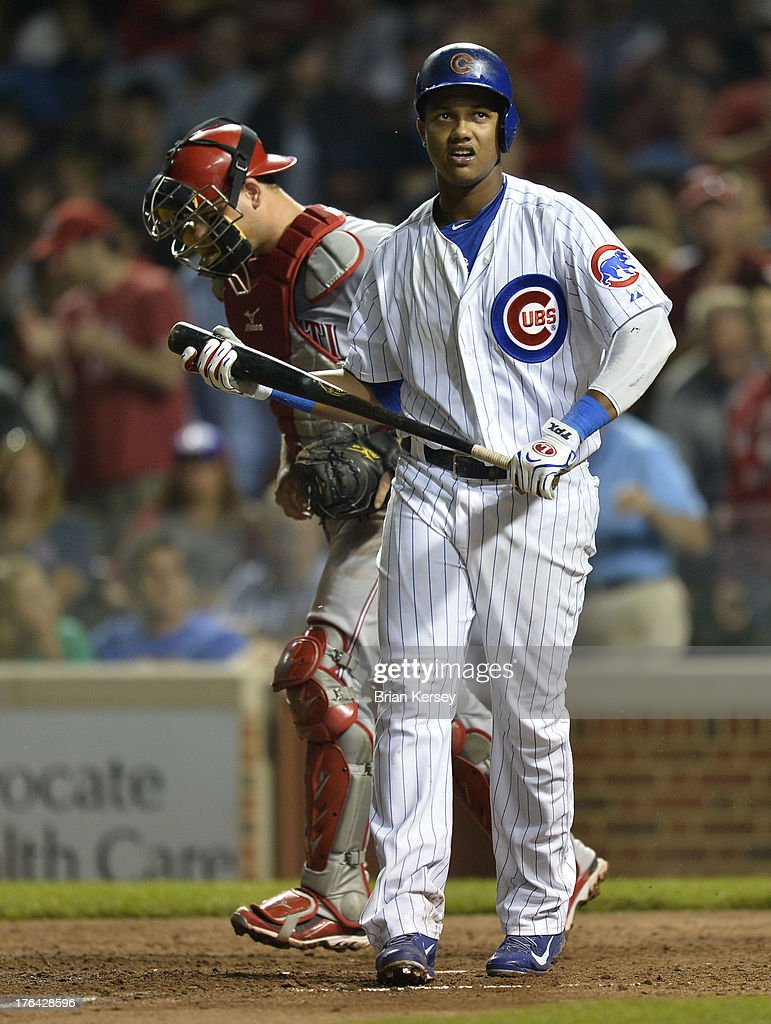 <a gi-track='captionPersonalityLinkClicked' href=/galleries/search?phrase=Starlin+Castro&family=editorial&specificpeople=5970945 ng-click='$event.stopPropagation()'>Starlin Castro</a> #13 of the Chicago Cubs walks back to the dugout after striking out for the final out of the ninth inning against the Cincinnati Reds at Wrigley Field on August 12, 2013 in Chicago, Illinois. The Reds defeated the Cubs 2-0.