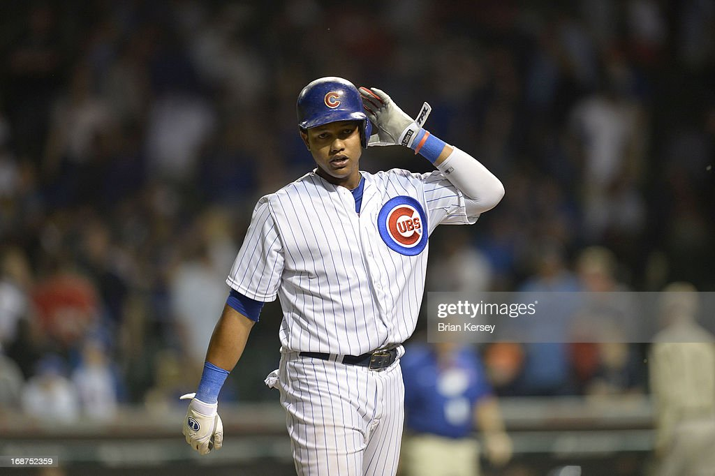 <a gi-track='captionPersonalityLinkClicked' href=/galleries/search?phrase=Starlin+Castro&family=editorial&specificpeople=5970945 ng-click='$event.stopPropagation()'>Starlin Castro</a> #13 of the Chicago Cubs walks off the field after making the final out of the ninth inning against the Colorado Rockies on May 14, 2013 at Wrigley Field in Chicago, Illinois. The Rockies defeated the Cubs 9-4.