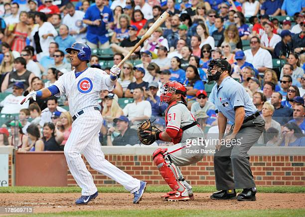 Starlin Castro of the Chicago Cubs watches his home run against the Philadelphia Phillies during the sixth inning on August 31 2013 at Wrigley Field...
