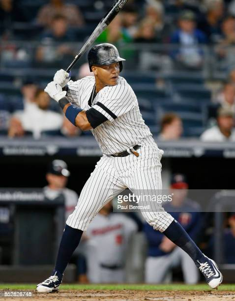 Starlin Castro of the New York Yankees bats as his helmet and bat are covered with rosin dust in an MLB baseball game against the Minnesota Twins on...