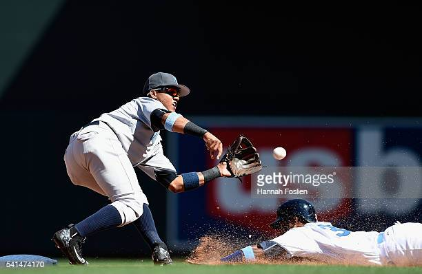 Starlin Castro of the New York Yankees catches Danny Santana of the Minnesota Twins stealing second base during the eighth inning of the game on June...