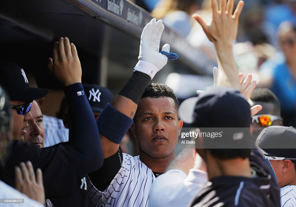 <a gi-track='captionPersonalityLinkClicked' href=/galleries/search?phrase=Starlin+Castro&family=editorial&specificpeople=5970945 ng-click='$event.stopPropagation()'>Starlin Castro</a> #14 of the New York Yankees celebrates after hitting a home run against the Toronto Blue Jays in the first inning during their game at Yankee Stadium on May 26, 2016 in New York City.