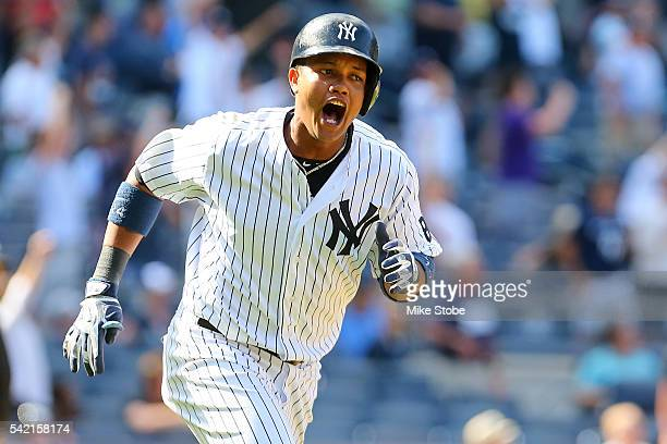 Starlin Castro of the New York Yankees celebrates after hitting a game winning solo home run in the bottom of the ninthinning to defet the Colorado...