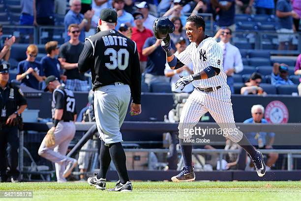 Starlin Castro of the New York Yankees celebrates after hitting a game winning solo home run in the bottom of the ninthinning as Jason Motte of the...