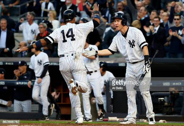 Starlin Castro of the New York Yankees celebrates after scoring on a Starlin Castro single with Todd Frazier during the second inning against the...
