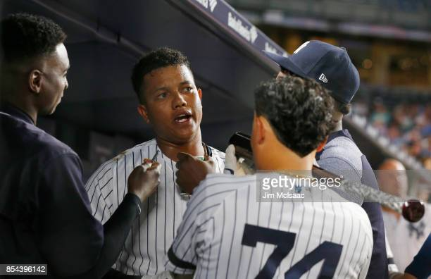 Starlin Castro of the New York Yankees celebrates his second inning home run against the Tampa Bay Rays by granting an 'interview' to teammates Didi...