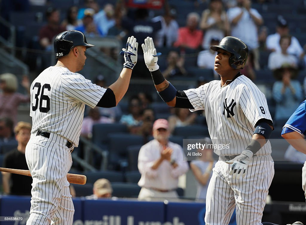 <a gi-track='captionPersonalityLinkClicked' href=/galleries/search?phrase=Starlin+Castro&family=editorial&specificpeople=5970945 ng-click='$event.stopPropagation()'>Starlin Castro</a> #14 of the New York Yankees celebrates with <a gi-track='captionPersonalityLinkClicked' href=/galleries/search?phrase=Carlos+Beltran&family=editorial&specificpeople=167108 ng-click='$event.stopPropagation()'>Carlos Beltran</a> #36 after hitting a home run against the Toronto Blue Jays in the first inning during their game at Yankee Stadium on May 26, 2016 in New York City.