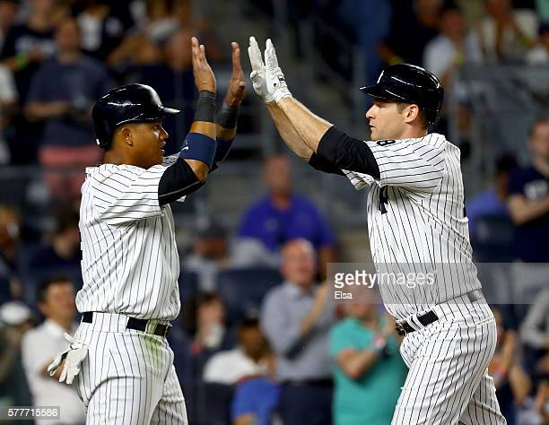 Starlin Castro of the New York Yankees celebrates with teammate Chase Headley after Headley hit a two run home run in the eighth inning against the...