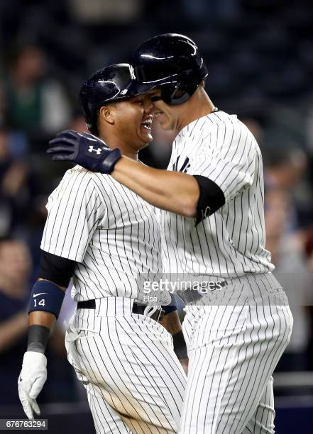 Starlin Castro of the New York Yankees congratulates teamamte Aaron Judge after Judge hit a three run home run in the seventh inning against the...