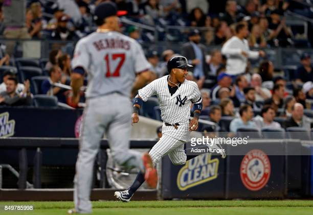 Starlin Castro of the New York Yankees heads home to score a run past Jose Berrios of the Minnesota Twins during the second inning at Yankee Stadium...