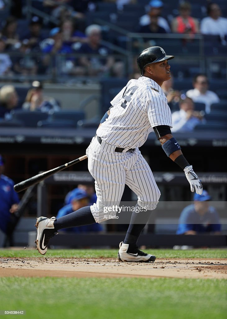 <a gi-track='captionPersonalityLinkClicked' href=/galleries/search?phrase=Starlin+Castro&family=editorial&specificpeople=5970945 ng-click='$event.stopPropagation()'>Starlin Castro</a> #14 of the New York Yankees hits a home run against the Toronto Blue Jays in the first inning during their game at Yankee Stadium on May 26, 2016 in New York City.