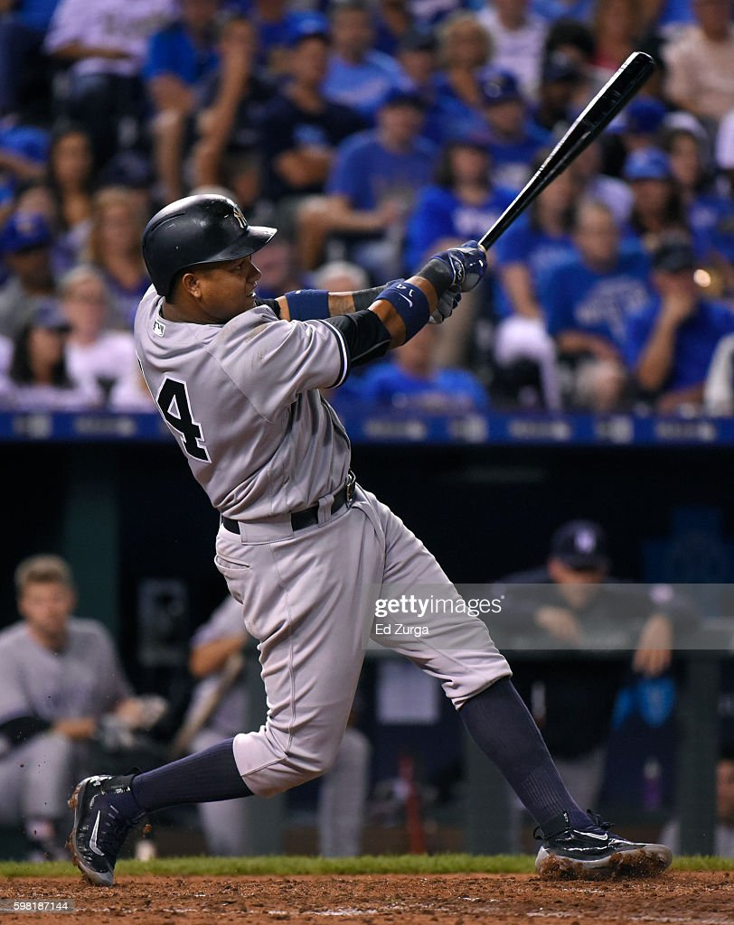 Starlin Castro #14 of the New York Yankees hits a two-run home run in the sixth inning against the Kansas City Royals at Kauffman Stadium on August 31, 2016 in Kansas City, Missouri.