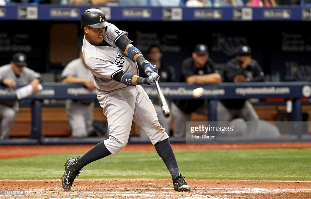 <a gi-track='captionPersonalityLinkClicked' href=/galleries/search?phrase=Starlin+Castro&family=editorial&specificpeople=5970945 ng-click='$event.stopPropagation()'>Starlin Castro</a> #14 of the New York Yankees hits a two-run home run off of pitcher Jake Odorizzi of the Tampa Bay Rays during the seventh inning of a game on May 29, 2016 at Tropicana Field in St. Petersburg, Florida.