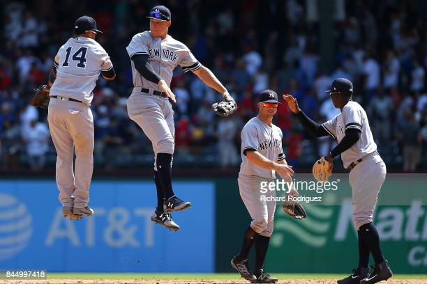 Starlin Castro of the New York Yankees leaps with Aaron Judge of the New York Yankees as they celebrate the win over the Texas Rangers at Globe Life...