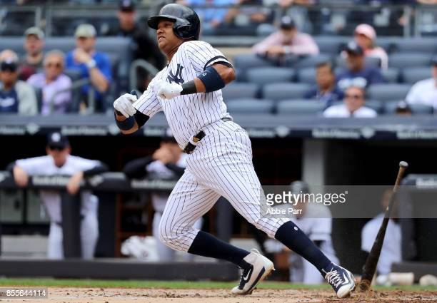 Starlin Castro of the New York Yankees reaches an infield single to score Jacoby Ellsbury in the first inning against the Toronto Blue Jays at Yankee...