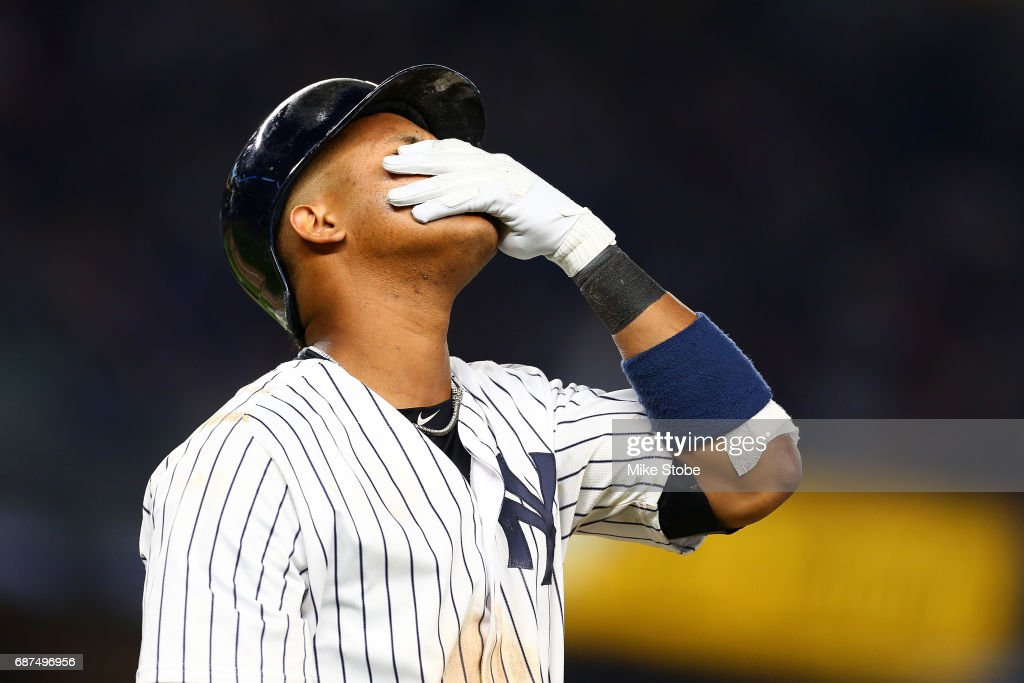 Starlin Castro #14 of the New York Yankees reacts after flying out to center field in the eighth inning against the Kansas City Royals at Yankee Stadium on May 23, 2017 in the Bronx borough of New York City.