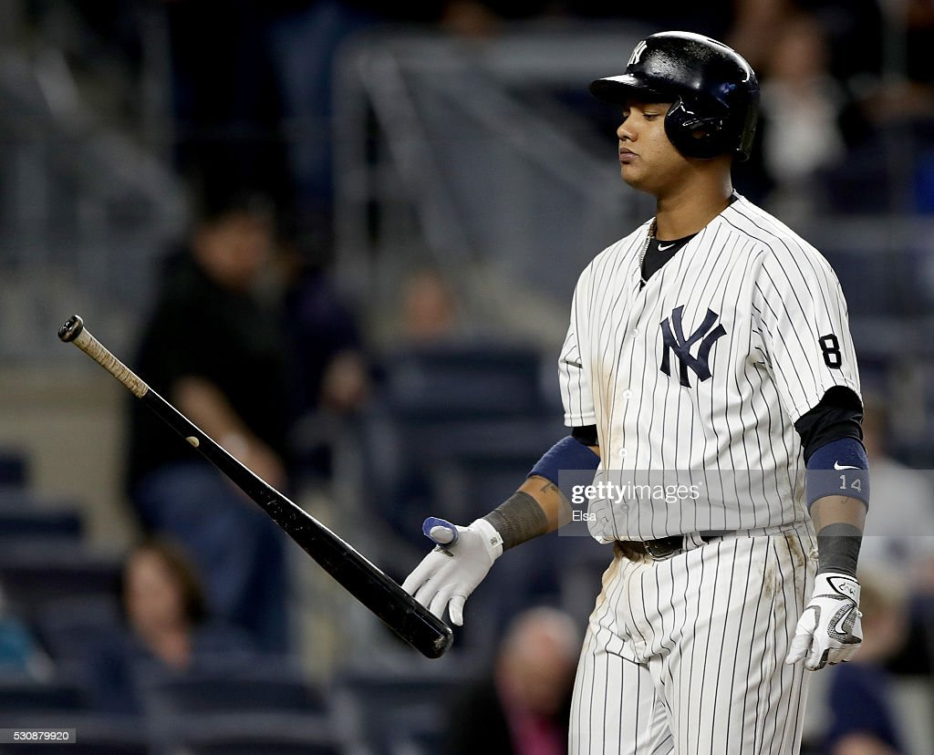 <a gi-track='captionPersonalityLinkClicked' href=/galleries/search?phrase=Starlin+Castro&family=editorial&specificpeople=5970945 ng-click='$event.stopPropagation()'>Starlin Castro</a> #14 of the New York Yankees reacts after he struck out to end the ninth inning against the Kansas City Royals at Yankee Stadium on May 11, 2016 in the Bronx borough of New York City.The Kansas City Royals defeated the New York Yankees 7-3.