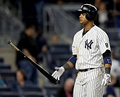 Starlin Castro of the New York Yankees reacts after he struck out to end the ninth inning against the Kansas City Royals at Yankee Stadium on May 11...