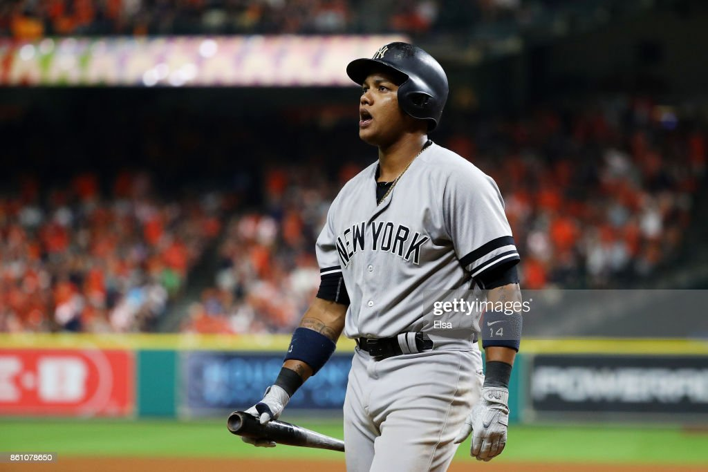 Starlin Castro #14 of the New York Yankees reacts after striking out in the ninth inning against the Houston Astros during game one of the American League Championship Series at Minute Maid Park on October 13, 2017 in Houston, Texas.