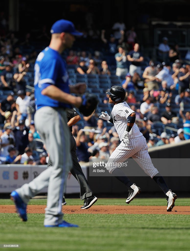 <a gi-track='captionPersonalityLinkClicked' href=/galleries/search?phrase=Starlin+Castro&family=editorial&specificpeople=5970945 ng-click='$event.stopPropagation()'>Starlin Castro</a> #14 of the New York Yankees rounds the bases after hitting a home run against <a gi-track='captionPersonalityLinkClicked' href=/galleries/search?phrase=J.A.+Happ&family=editorial&specificpeople=4175351 ng-click='$event.stopPropagation()'>J.A. Happ</a> #33 of the Toronto Blue Jays in the first inning during their game at Yankee Stadium on May 26, 2016 in New York City.
