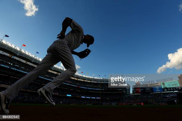Starlin Castro of the New York Yankees runs onto the field for warmups prior to the start of the game against the Baltimore Orioles at Yankee Stadium...