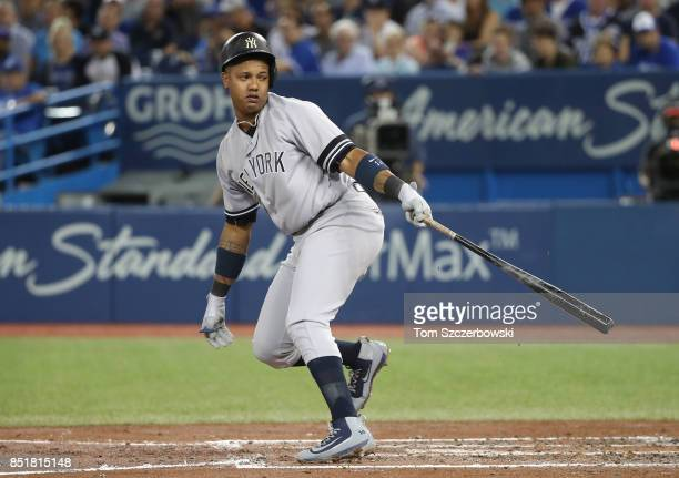 Starlin Castro of the New York Yankees strikes out in the fourth inning during MLB game action against the Toronto Blue Jays at Rogers Centre on...