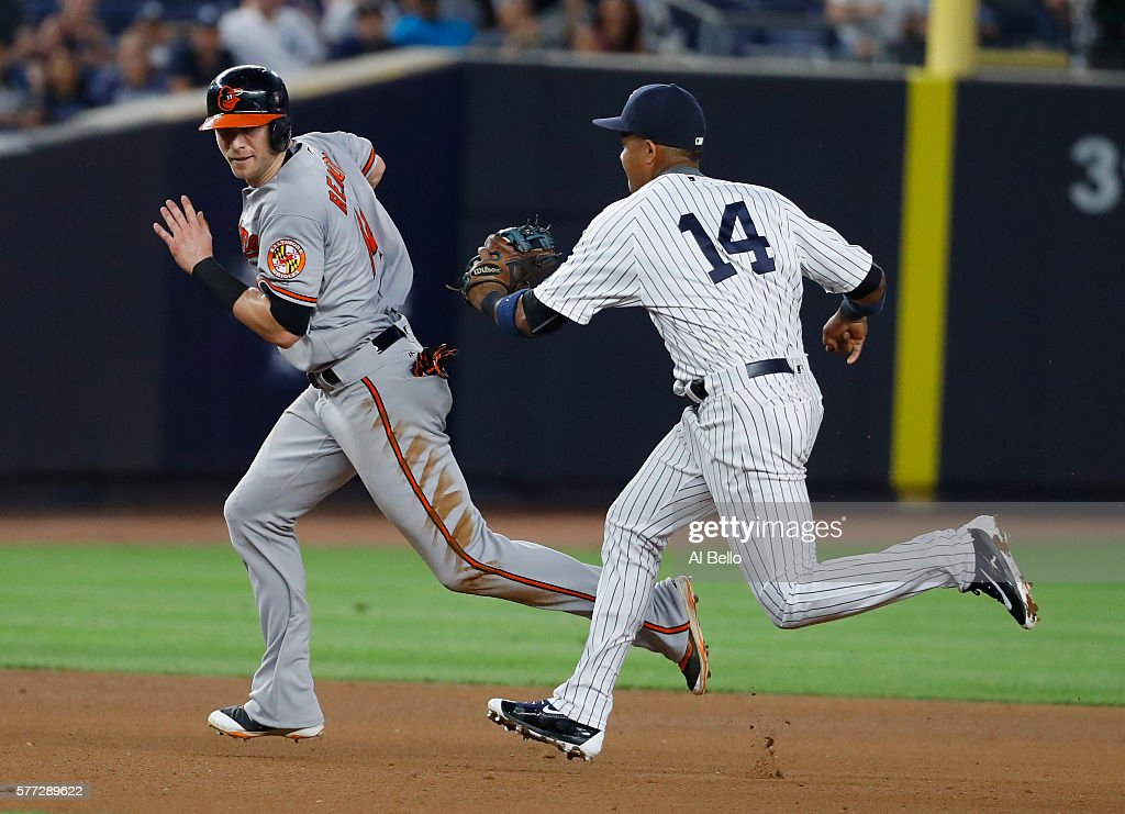 Starlin Castro #14 of the New York Yankees tags out Nolan Reimold #14 of the Baltimore Orioles during their game at Yankee Stadium on July 18, 2016 in New York City.