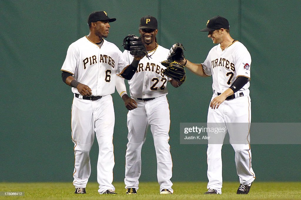 <a gi-track='captionPersonalityLinkClicked' href=/galleries/search?phrase=Starling+Marte&family=editorial&specificpeople=7934200 ng-click='$event.stopPropagation()'>Starling Marte</a> #6, <a gi-track='captionPersonalityLinkClicked' href=/galleries/search?phrase=Andrew+McCutchen&family=editorial&specificpeople=2364814 ng-click='$event.stopPropagation()'>Andrew McCutchen</a> #22 and Alex Presley #7 of the Pittsburgh Pirates celebrate after defeating the St. Louis Cardinals during game two of a doubleheader on July 30, 2013 at PNC Park in Pittsburgh, Pennsylvania. The Pirates defeated the Cardinals 6-0.