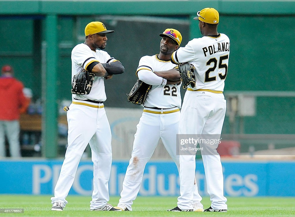 <a gi-track='captionPersonalityLinkClicked' href=/galleries/search?phrase=Starling+Marte&family=editorial&specificpeople=7934200 ng-click='$event.stopPropagation()'>Starling Marte</a> #6, <a gi-track='captionPersonalityLinkClicked' href=/galleries/search?phrase=Andrew+McCutchen&family=editorial&specificpeople=2364814 ng-click='$event.stopPropagation()'>Andrew McCutchen</a> #22 and <a gi-track='captionPersonalityLinkClicked' href=/galleries/search?phrase=Gregory+Polanco&family=editorial&specificpeople=11178456 ng-click='$event.stopPropagation()'>Gregory Polanco</a> #25 of the Pittsburgh Pirates celebrate after a 6-2 win over the Philadelphia Phillies on July 6, 2014 at PNC Park in Pittsburgh, Pennsylvania.