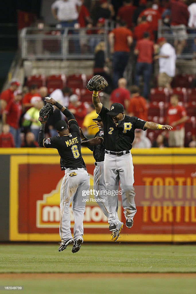 <a gi-track='captionPersonalityLinkClicked' href=/galleries/search?phrase=Starling+Marte&family=editorial&specificpeople=7934200 ng-click='$event.stopPropagation()'>Starling Marte</a> #6, <a gi-track='captionPersonalityLinkClicked' href=/galleries/search?phrase=Andrew+McCutchen&family=editorial&specificpeople=2364814 ng-click='$event.stopPropagation()'>Andrew McCutchen</a> #22 and <a gi-track='captionPersonalityLinkClicked' href=/galleries/search?phrase=Marlon+Byrd&family=editorial&specificpeople=217377 ng-click='$event.stopPropagation()'>Marlon Byrd</a> #2 of the Pittsburgh Pirates celebrate after the final out against the Cincinnati Reds during the game at Great American Ball Park on September 27, 2013 in Cincinnati, Ohio. The Pirates won 4-1.