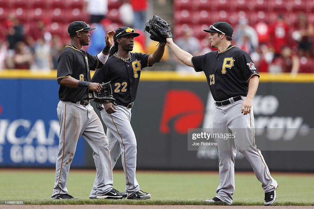 Starling Marte #6, <a gi-track='captionPersonalityLinkClicked' href=/galleries/search?phrase=Andrew+McCutchen&family=editorial&specificpeople=2364814 ng-click='$event.stopPropagation()'>Andrew McCutchen</a> #22 and <a gi-track='captionPersonalityLinkClicked' href=/galleries/search?phrase=Travis+Snider&family=editorial&specificpeople=4959427 ng-click='$event.stopPropagation()'>Travis Snider</a> #23 of the Pittsburgh Pirates celebrate after the final out of the game against the Cincinnati Reds at Great American Ball Park on August 5, 2012 in Cincinnati, Ohio. The Pirates won 6-2.