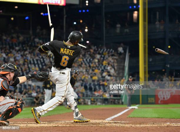 Starling Marte of the Pittsburgh Pirates breaks his bat on an RBI single in the seventh inning during the game against the Baltimore Orioles at PNC...