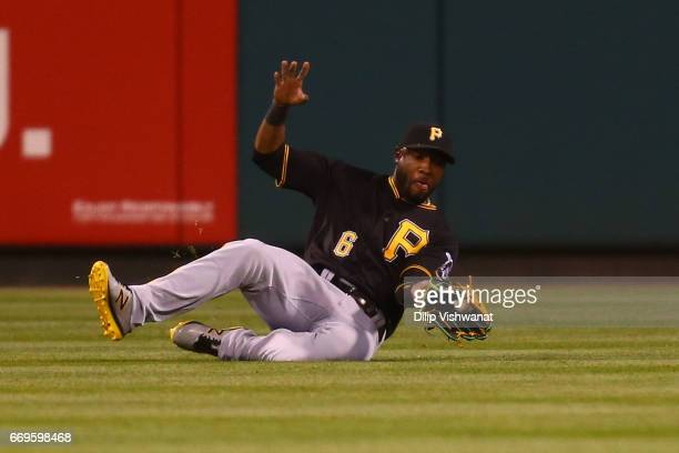 Starling Marte of the Pittsburgh Pirates catches a line drive against the St Louis Cardinals in the eighth inning at Busch Stadium on April 17 2017...