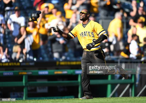 Starling Marte of the Pittsburgh Pirates celebrates after hitting a two run home run during the tenth inning against the Atlanta Braves at PNC Park...
