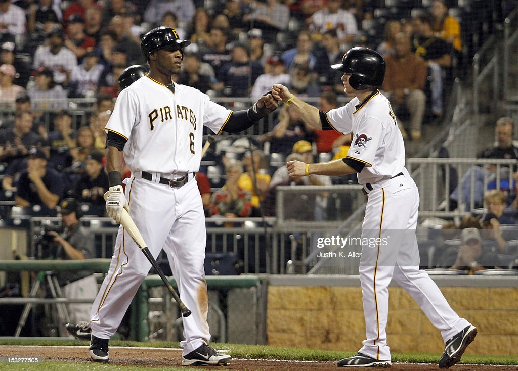<a gi-track='captionPersonalityLinkClicked' href=/galleries/search?phrase=Starling+Marte&family=editorial&specificpeople=7934200 ng-click='$event.stopPropagation()'>Starling Marte</a> #6 of the Pittsburgh Pirates celebrates after scoring in the first inning against the Atlanta Braves during the game on October 2, 2012 at PNC Park in Pittsburgh, Pennsylvania.